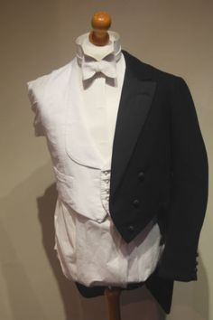 1920s White Tie Evening Tailcoat Suit. Stiff bib with the detachable collar. Also like the curved waistcoat instead of the typical shape of nowadays