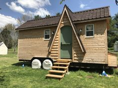 A custom tiny house partially built with on-site milled lumber by Rachel Jones and her father in Tennessee.