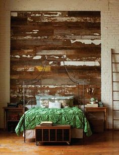 Scrap wood used to create a rustic look for your bedroom wall, sort of like a foe headboard. .