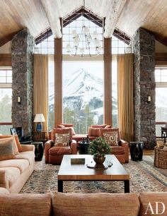 A snowcapped mountain serves as a dramatic focal point for a Big Sky, Montana, living room decorated by Michael S. Smith | archdigest.com