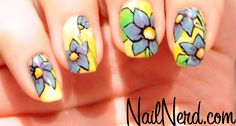 Bloomin' Spring Nails  A great little tip on painting flowers white before adding color