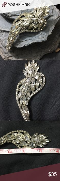 """Large Vintage Art Deco Rhinestone Brooch 4"""" ❤️ Large Vintage Art Deco Rhinestone Brooch nearly 4"""" Long. I have had this in my jewelry box for over 20 years. It is beautiful but I haven't reached for it in so long so it is time to find it a new home. It is lovely and very large. I think it would make a beautiful hairpiece or statement piece on a jacket or coat. In beautiful condition. Unmarked. Bundle and save. Will come boxed for giftgiving or for storage. Vintage Jewelry Brooches"""