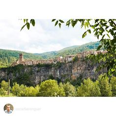 Castellfollit de la Roca is one of the most picturesque villages in Catalonia. Its church and houses cling to the top of a spectacular basalt rock face, and this has become one of the most widely used images of the region. +INFO www.castellfollitdelaroca.org. Picture by @oscarberenguer (Instagram)
