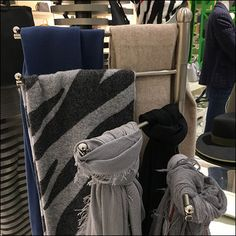 Though orientation in any direction is possible, this Nordstrom Swivel Scarf-Arm Presentation seemed the best arrangement to mass merchandise visually. Scarf Display, Retail Fixtures, Scarf Knots, Visual Merchandising, Oriental, Presentation, Arms, Nordstrom, Blanket