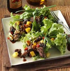 Caribbean Beef Short Ribs Recipe -This is a fantastic change of pace from a typical slow cooker stew. Its combination of flavors—short ribs, rum and fruit— makes it feel like an exotic Caribbean dish. Make sure to leave the mangoes and pineapple on top of the beef, instead of stirring them in, so that their color will stay bright yellow. When removing the mixture from the slow cooker, take out the fruit first and place in a separate bowl from the meat to avoid coating them with the wit...