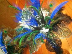Feather bouquets I made for my wedding decorations! #DIY #peacock #feathers #feather #blue #metal