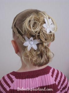 this style is great for girls with fine hair because the messy buns make it look like there's much more to it. (doing this to my girl's hair when I have kids!) so cute!