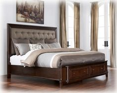 Larimer bed. Beautiful tufted upholstered headboard framed with rich wood, and storage drawers on footboard.  -by Ashley Furniture-