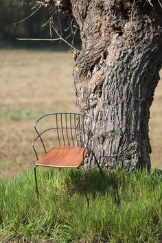 Flint | Marc Sadler  4-leg armchair with steel frame and backrest, iroko wood seat.