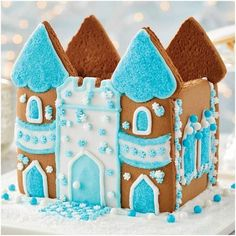 Snowy Castle Gingerbread House Kit - Be the king or queen of your castle with this enchanted winter gingerbread castle kit. Includes everything you need. Includes 3 types of candy, blue decorating sugar, white fondant, white ready-to-use icing, 2 decorating bags & tips, (4) Candy Cup Holders, & instruction sheet. #gingerbreadhouse #castle #gingerbreadcastle Best Gingerbread House Kit, Gingerbread Cookie Mix, Cardboard Gingerbread House, Gingerbread Reindeer, Gingerbread Castle, Cool Gingerbread Houses, Classic Holiday Movies, Types Of Candy, Cookie House