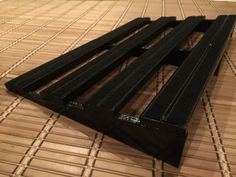 Black pedalboard 60cm by 40cm. Coloured and lacquered finished topped with velcro. Riffs & Records Pedalboards.