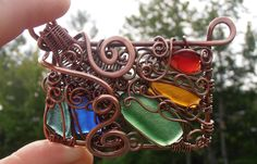 ...although summer is my favorite time of year, I find it extremely difficult to create...too much to do outside and not enough time for creating..:) Here is a piece I just finished..my rendition on stained glass window..:) Chain yet to be made...Pendant made out of copper wire and sea glass..www.facebook.com/leblanc.petra