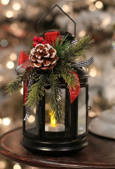 8 Inch Black Metal Christmas Lantern with Holiday Decor and Tea Light. Love the black and red used together. They will add a bold point of color to the centerpiece. CT***