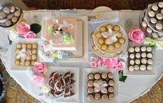 Aerial view of blush wedding cake & mini desserts, set up at La Valencia Hotel, La Jolla