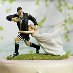Love Match Rugby Couple Cake Topper (Wedding Star 9016)   Buy at Wedding Favors Unlimited (http://www.weddingfavorsunlimited.com/love_match_rugby_couple_cake_topper.html).