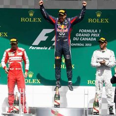 Red Bull Formula One driver Sebastian Vettel (C) of Germany celebrates on the podium after winning the Canadian Grand Prix 2013 Formula 1, Montreal, Canadian Grand Prix, Gilles Villeneuve, Racing Events, Red Bull Racing, Canada, Domingo