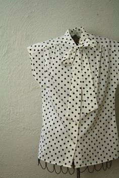 I really want a shirt that ties at the neck. better yet with polka dots :]