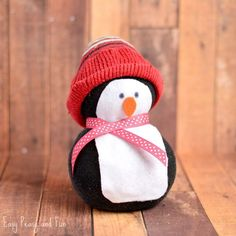 No-Sew Sock Penguin Craft - Easy Peasy and Fun - Noontime - amazing craft Sock Snowman Craft, Penguin Craft, Sock Crafts, Fun Crafts, Decor Crafts, Santa Crafts, Snowman Crafts, Holiday Crafts, Christmas Diy
