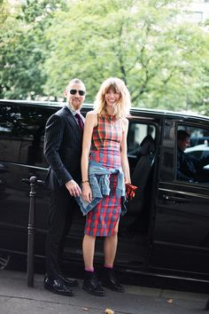 Veronika Heilbrunner in plaid McQ and a Denim jacket wrapped around her waist with her beau Justin O'Shea...Paris. #HauteCouture #FW14