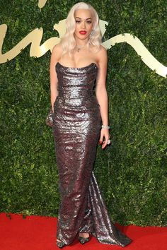 Rita Ora: w/ role in upcoming Fifty Shades of Grey film, Ora naturally goes for sultry style straight out of Old Hollywood; clingy, metallic Vivienne Westwood gown & Veronica Lake waves are just what any budding screen siren needs