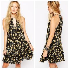 "•Free People Ruffle Tunic Dress• •Gorgeous free people tunic dress• Keyhole front & back with tie closure• Sleeveless• Tiered ruffled lower• Allover print black/ yellow• Approx. 33.5"" length• 100% rayon• Free People Dresses Midi"