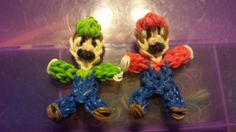 """LUIGE and MARIO. Designed and loomed by Victoria Vera on the Rainbow Loom. (Rainbow Loom FB page) Victoria said: """"I tried Luigi .so here are my guys. I made a vudeo but cant upload but I will try to draw it out. Rainbow Loom Patterns, Rainbow Loom Creations, Rainbow Loom Charms, Rainbow Loom Bracelets, Rainbow Loom Characters, Fun Loom, Loom Craft, Rubber Band Bracelet, Loom Bands"""
