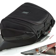 """MotoCentric Mototrek Sport Tail Bag - CLOSEOUT DEAL!  The MotoCentric Mototrek Sport Tail Bag - stylish and practical tail bag that's easy to mount and carry. 2 outside side pockets expanded and one large center compartment. The bag will keep its hard-bodied aerodynamic shape even when empty. There are also quick release buckles attached to this bag to pair it with MotoCentric's Sport Saddlebags to create a """"full matching luggage set""""."""
