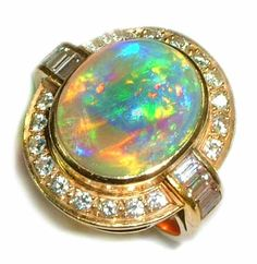 18k gold Dark Crystal opal ring with brilliant and baguette shaped diamonds. A feature for ladies opal ring fashions and jewelry (jewellery)
