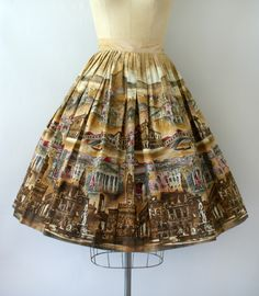 Vintage 1950s skirt, beautiful novelty cotton print features European city scenes, fitted waist, very full skirt, hidden side hook and eye closure