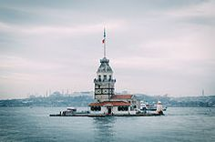 The Maiden's Tower (Turkish: Kız Kulesi), also known as Leander's Tower (Tower of Leandros) since the medieval Byzantine period, is a tower lying on a small islet located at the southern entrance of the Bosphorus strait 200 m (220 yd) from the coast of Üsküdar in Istanbul, Turkey.