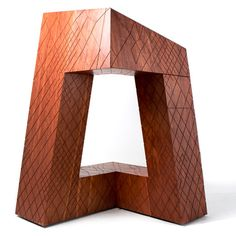 OMA's CCTV building reconstructed as a wooden cabinet.