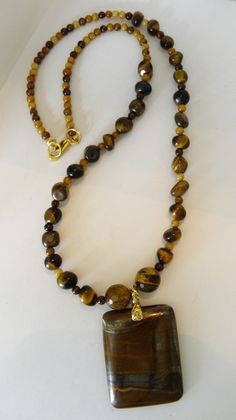 Beautiful Tiger Eye!  A stunning Pendant of Tiger Eye hangs from different sizes of the same semi-precious gemstone.  Includes matching earrings.    $30.00