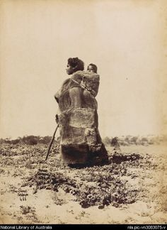 Portrait of unidentified Aboriginal woman wearing a possum skin cloak, carrying a child on her back, South Australia, ca. 1870s, from the National Library of Australia