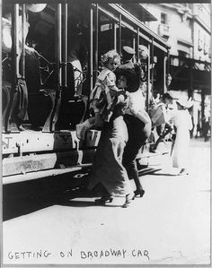 Streetcars - getting on Broadway car, July 11, 1913