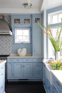 Geometric-patterned tile backsplashes send these 26 stylish kitchens to the next level of dynamic design. Get inspired to try a geometric kitchen backsplash in your own design., Think beyond subway tile. Küchen Design, House Design, Blue Kitchen Cabinets, Kitchen Cupboard, Stylish Kitchen, Beautiful Kitchens, Interior Design Kitchen, Home Kitchens, Beach Cottage Kitchens