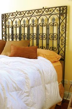 This is what I really want for a headboard -- the wrought iron gate so pretty!