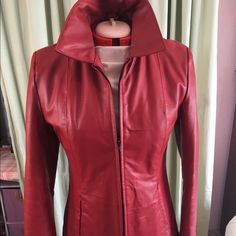Dark red leather jacket Quilted lining, zip pockets on front.  Only worn a couple of times. Jackets & Coats