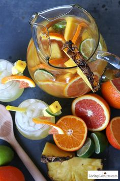 Put a tropical twist on the traditional white sangria with this fruity Pineapple Sangria recipe. A perfect drink for a luau party or sipping by the pool. A cocktail that makes you feel like you're at the beach! LivingLocurto.com