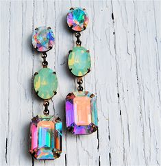 These pacific opal earrings reflect so many colors they could go with any summer outfit - Jewelry by Mashugana. So cool! It could totally change a plain black summer dress into SNAZZ-BALLS!