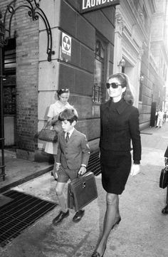 Jackie Kennedy taking John F Kennedy Jr back to school