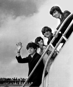 The Beatles, from left, Paul McCartney, Ringo Starr, John Lennon and George Harrison board a plane for England in New York.