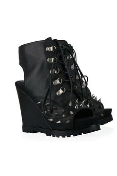 The sandals crafted in leather, featuring lace up fastening with metal eyelets, rivet embellishment to vamp, peep toe style with high wedge.