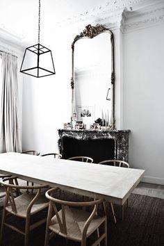 Suzie: Milk Magazine - Chic, eclectic dining room with Hans Wegner Wishbone Chairs, gray rug, ...