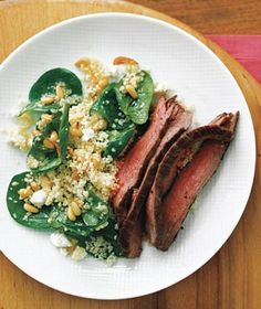 Steak With Spinach Couscous - made BBQ chicken instead - but we all loved the couscous! Yummy pine nuts roasted with garlic in olive oil, tossed with spinach, lemon juice, feta. Yum!