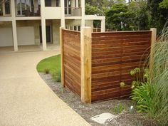 Horizontal merbau front feature wing fence with exposed posts and capping