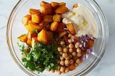 From  food52.com: Moro's warm squash-chickpea salad with tahini.   2014-0103_genius_butternut-squash-salad-tahini-487 by Photosfood52, via Flickr