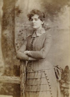 This is photography shows Miss Jennie Fisher and was taken 1886 by THE DOMINION in Toronto, Ont.