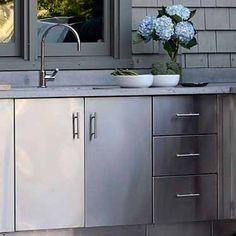 Riveting outdoor kitchen island frame kits with brushed for Custom stainless steel cabinet doors