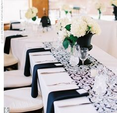 Table settings: White table cloth with black/white damask runners, red chargers and black napkins. square mirrors with tall cylindrical vase in center with red roses inside White Wedding Decorations, White Wedding Flowers, Table Decorations, Wedding Black, Elegant Wedding, White Flowers, Black Napkins, White Runners, Black Vase