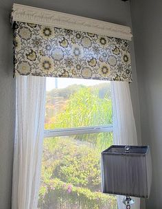 crown molding, fabric valance, and curtains